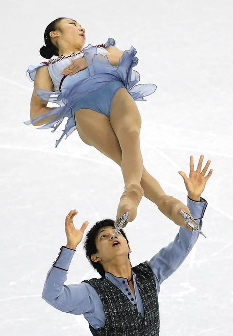 Narumi Takahashi and Ryuichi Kihara of Japan perform in the pair's free skating of the figure skating team event at Iceberg Skating Palace.