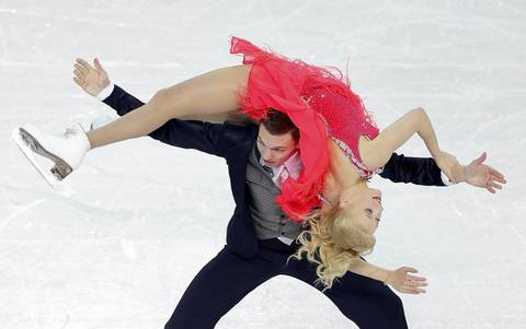 Ekaterina Bobrova and Dmitri Soloviev of Russia compete in the figure skating team ice dance - short dance at Iceberg Skating Palace.