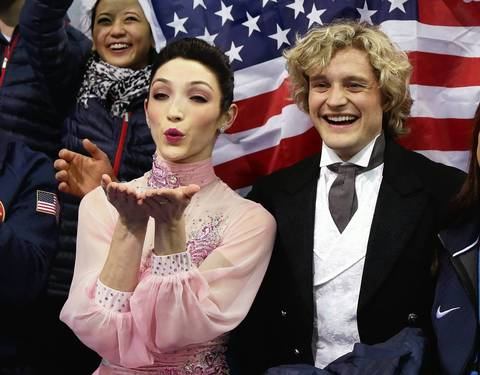 U.S. skaters Meryl Davis and Charlie White wait for their score during the figure skating team ice dance short dance at Iceberg Skating Palace.