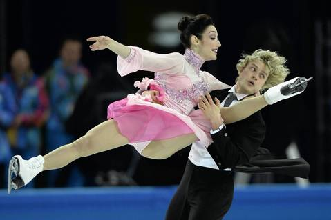 U.S. skaters Meryl Davis and Charlie White perform in the figure skating team ice dance short dance at the Iceberg Skating Palace.