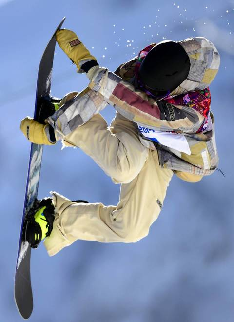U.S. snowboarder Sage Kotsenburg competes during the men's snowboard slopestyle final at the Rosa Khutor Extreme Park.