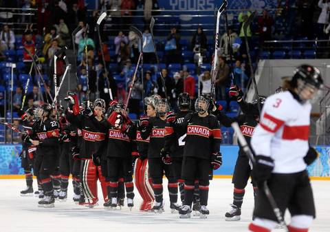 Canada acknowledges the crowd after their 5-0 win over Switzerland in a women's hockey game at the Winter Olympics.