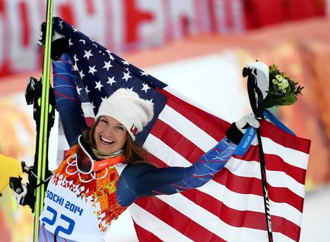 "U.S. skier Julia Mancuso celebrates her bronze medal win in the women's super combined skiing at the Rosa Khutor Alpine Center. ""It was my first event where a U.S. competitor placed, so it was fun to make that classic picture of her wrapped in an American flag. Mancuso is a total ham and was enjoying her moment, playing to the crowd and jumping on the podium."""