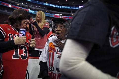 80-year-old Bulls fan Gloria Hinton reacts to getting Joakim Noah's autograph before Tuesday's Bulls game.