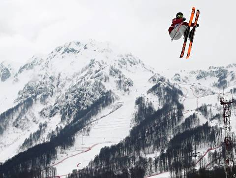 "Dara Howell, of Canada, competes in the ladies' ski slopestyle on her way to a gold medal at the Rosa Khutor Extreme Park. ""Another long day on the mountain. I started with the finals of the ladies ski slopestyle, partially because I'd been loving the photos that had been coming from the course during snowboard competitions few days ago. The mountain backdrops are beautiful and clean and I'd love to have more time to work with them."""
