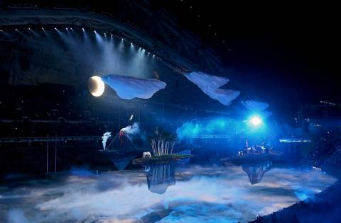 Scenes highlighting Russia's rich landscape and cultural diversity float past the audience during the opening ceremony for the Winter Olympics.