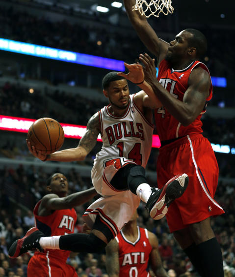 D.J. Augustin drives against the Hawks' Elton Brand in the 2nd quarter.