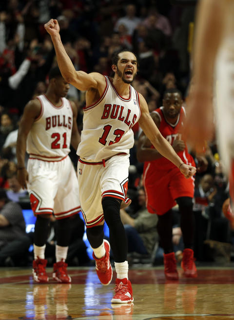 Joakim Noah celebrates after capping off his triple-double with two free throws.