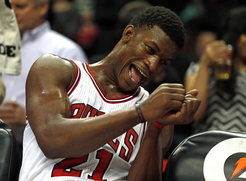 Jimmy Butler goofs around on the bench during final minutes of 100-85 win over the Hawks.