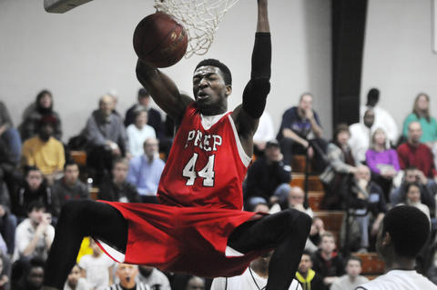 Fairfield Prep's Paschal Chukwu, 44, scores two points on this dunk during the third period.