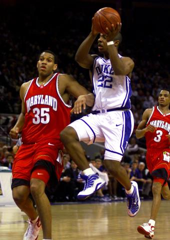 Jason William goes up for a layup past Lonny Baxter in the 2000 ACC championship.