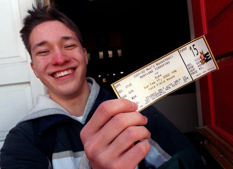 Mike Yuenger, a Maryland freshman from Crofton, happily displays the final ticket issued to students for the 2002 Duke-Maryland game at Cole Field House. He had camped outside the arena overnight.