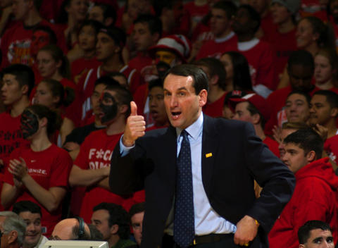 Duke coach Mike Krzyzewski gives a thumbs up to his team.
