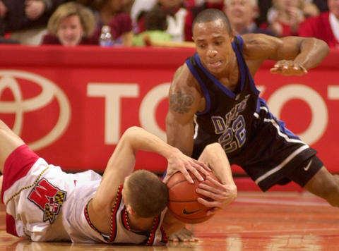 Steve Blake comes up with the ball as Jason Williams tries to regain possession.