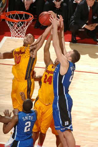 Mike Plumlee fights for a rebound against Jordan Williams and Cliff Tucker.