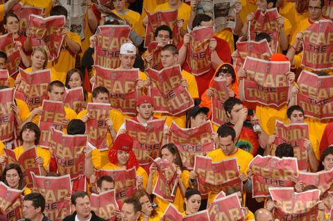 Maryland students hold up signs before a game against Duke.