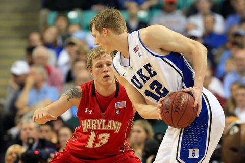 Kyle Singler  looks to drive against Haukur Palsson during an ACC quarterfinal.