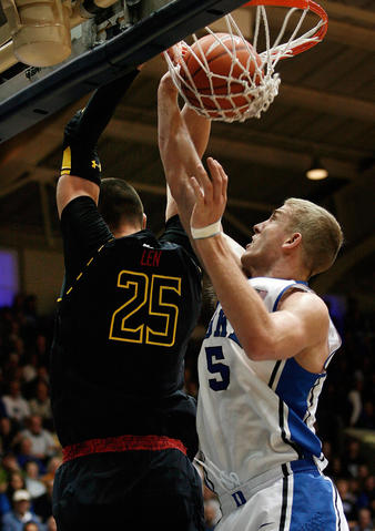 Alex Len reverse dunks over Mason Plumlee.