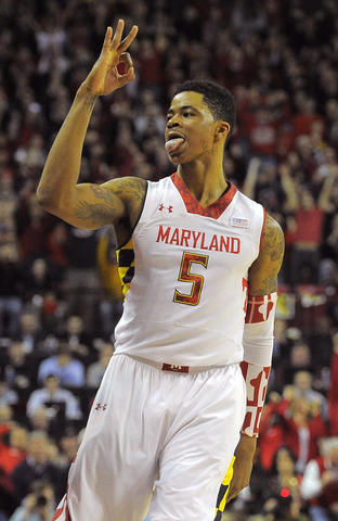 Nick Faust gestures after draining a 3-pointer.