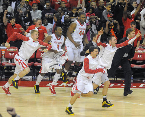 Maryland's bench empties onto the floor as the final seconds tick off the clock.