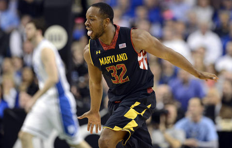 Dez Wells celebrates a basket against the Dukein the ACC quarterfinals.