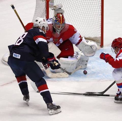 "USA forward Patrick Kane (88) is denied by Russia goalie Sergei Bobrovsky (72) in the overtime period. ""Overtime failed to produce a goal despite two big chances by Patrick Kane, which was too bad because it would have made a great picture and story in Chicago with a Blackhawk game-winner."""
