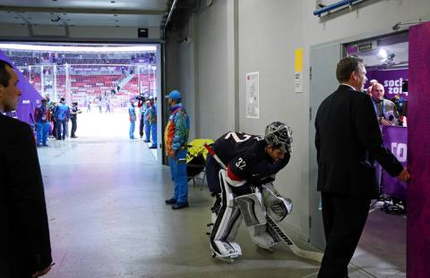"""On the way back to the photo room I spotted goalie Jonathan Quick waiting to talk to the media. It looked like he was stretching out to recover after such a long game in goal."""