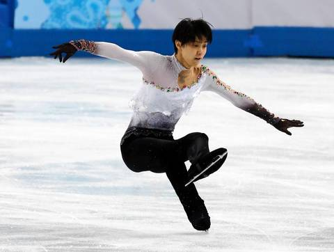 "Yuzuru Hanyu, of Japan, falls during the men's free skate figure skating. ""Japan's Hanyu was a heavy favorite going in, but he had a few stumbles on a couple of his jumps. I thought that would be a huge story if he lost and was glad to have a picture."""