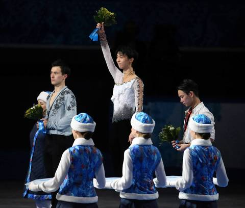 """Hanyu's score was enough for the gold medal."" Yuzuru Hanyu, center, of Japan, celebrates after winning the gold medal in men's figure skating. Patrick Chan of Canada, left, won the silver medal and Denis Ten, right, won the bronze."