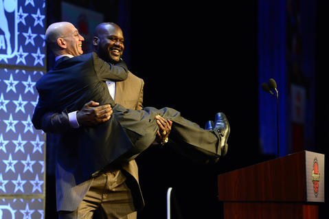 Shaquille O'Neal picks up NBA commissioner Adam Silver as O'Neal is honored as the Legend of the Year during the 2014 NBA All-Star Game Legend Brunch at Ernest N. Morial Convention Center.