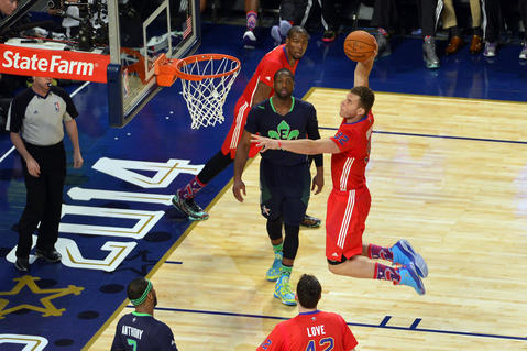 Western Conference's Blake Griffin dunks the ball against the Eastern Conference.