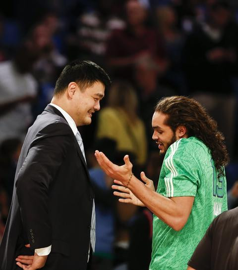 Former NBA player Yao Ming speaks with the Bulls' Joakim Noah before the 63rd NBA All-Star Game. in New Orleans, ouisiana, USA, 16 February 2014. EPA/PAUL BUCK CORBIS OUT