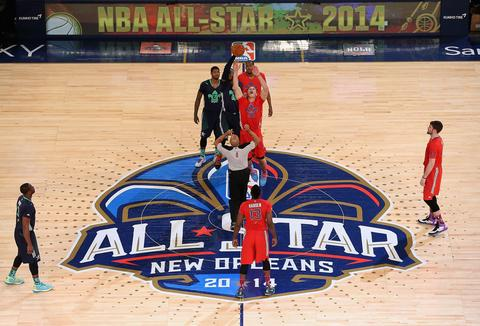 The Eastern Conference's Carmelo Anthony and Western Conference's Blake Griffin jump for the opening tip.