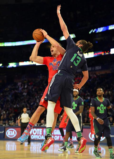 Western Conference forward Blake Griffin of the Clippers goes against Eastern Conference center Joakim Noah of the Bulls.