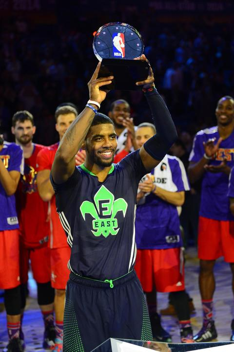 Eastern Conference Kyrie Irving guard of the Cavaliers celebrates with the MVP trophy.