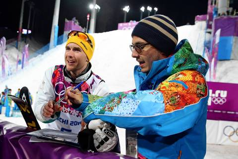 """One funny moment afterward was while David Morris, left, was just walking off the podium still wrapped in an Australian flag, an official walked up with paperwork for the silver medalist to take his mandatory drug screening. Apparently timing was of the essence. Morris took it in stride and walked on to celebrate with friends."""