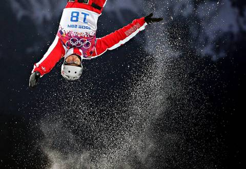 """Some of the tighter shots showed the spray of the snow as they left the jump quite well too. The sport is amazing and terrifying. Unlike ski jumping where the athletes travel a huge distance but aren't very far off the ground, aerial skiers launch nearly straight up and are way off the ground for several rotations."" Thomas Lambert, of Switzerland, sails through the air during qualification for men's aerials."