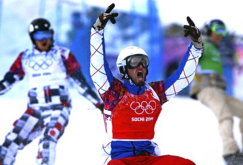 Pierre Vaultier of France celebrates after winning gold in the men`s snowboard cross at Rosa Khutor Extreme Park.