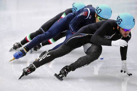 Eduardo Alvarez, of the United States, leads the pack in the men's short track 500m heat at Iceberg Skating Palace.