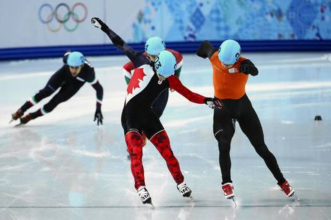 Charle Cournoyer, of Canada, and Freek Van Der Wart, of the Netherlands, cross the finish line in their men's short track 500m heat at Iceberg Skating Palace.