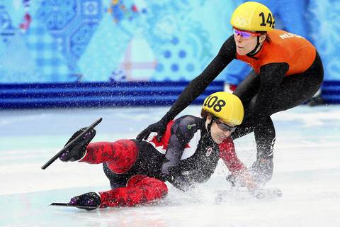 Marianne St. Gelais, of Canada, falls while competing in her ladies 1000m short track heat at Iceberg Skating Palace.