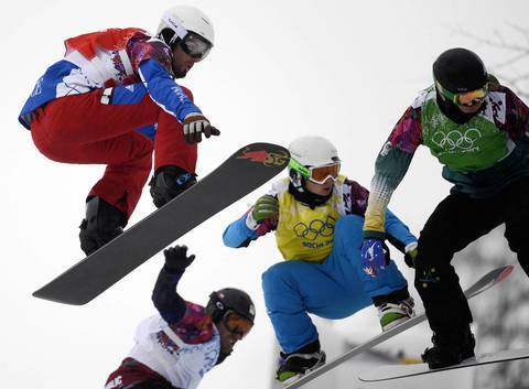France's Pierre Vaultier, left, races in Heat 6 of the men's snowboard cross 1/8 finals at the Rosa Khutor Extreme Park.