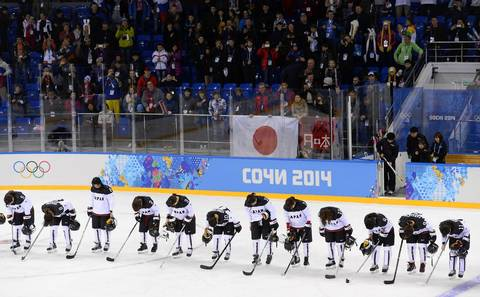 Japan's players salute their supporters after being defeated in the women's ice hockey 5th-8th place classifications match between Germany and Japan at the Shayba Arena.