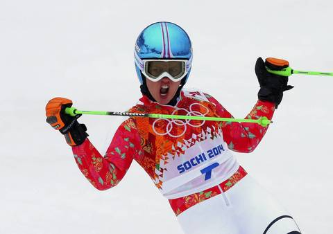 Viktoria Rebensburg, of Germany, celebrates her run during the Alpine skiing women's giant slalom.