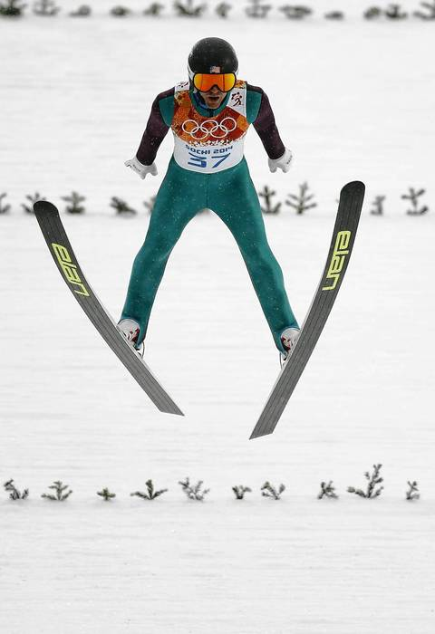 Bryan Fletcher, of the U.S., competes in the nordic combined individual gunderson at RusSki Gorki Ski Jumping Center.