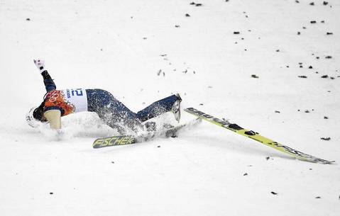 Taihei Kato, of Japan, crashes as he competes in the Nordic combined men's individual LH at RusSki Gorki Jumping Center.