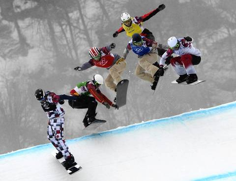 (Left to right) Nikolay Olyunin, of Russia, Lucas Eguibar, of Spain, Trevor Jacob, of USA, Alex Deibold, of USA, Stian Siveryzen, of Norway, and Kevin Hill, of Canada, compete in the first semifinal run in the men`s snowboard cross at Rosa Khutor Extreme Park