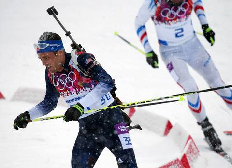 Tim Burke, of the USA, competes in the men's 15K mass start biathlon.