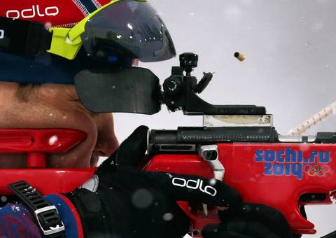 Ole Elnar Bjoerndalen, of Norway, prepares his rifle before the men's 15K mass start biathlon.