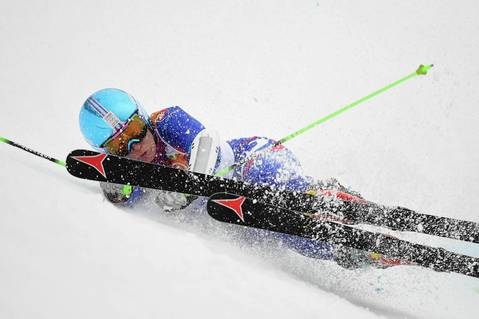 Slovakia's Kristina Saalova falls during the first run of the ladies Alpine skiing giant slalom at the Rosa Khutor Alpine Center.
